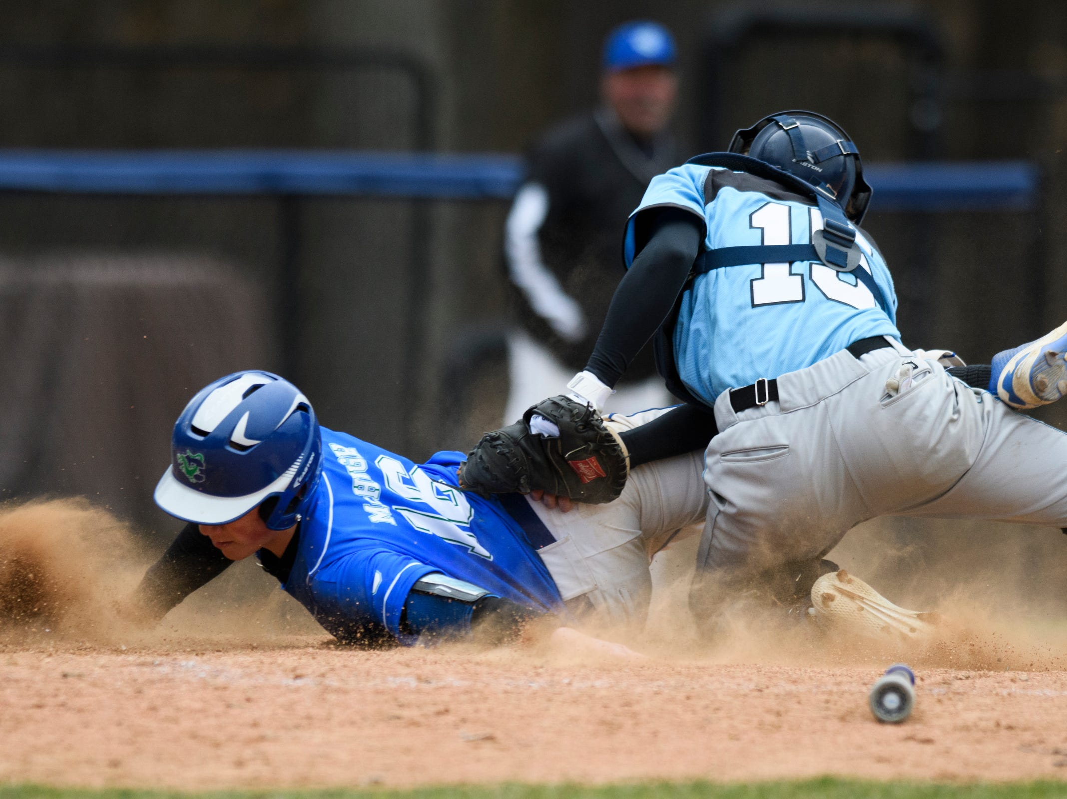 South Burlington catcher Brendan Precourt (15) tags out Colchester's Chris McHugh (16) as he slides into home plate during the boys baseball game between the South Burlington Wolves and the Colchester Lakers at Colchester high school on Thursday afternoon April 18, 2019 in Colchester, Vermont.