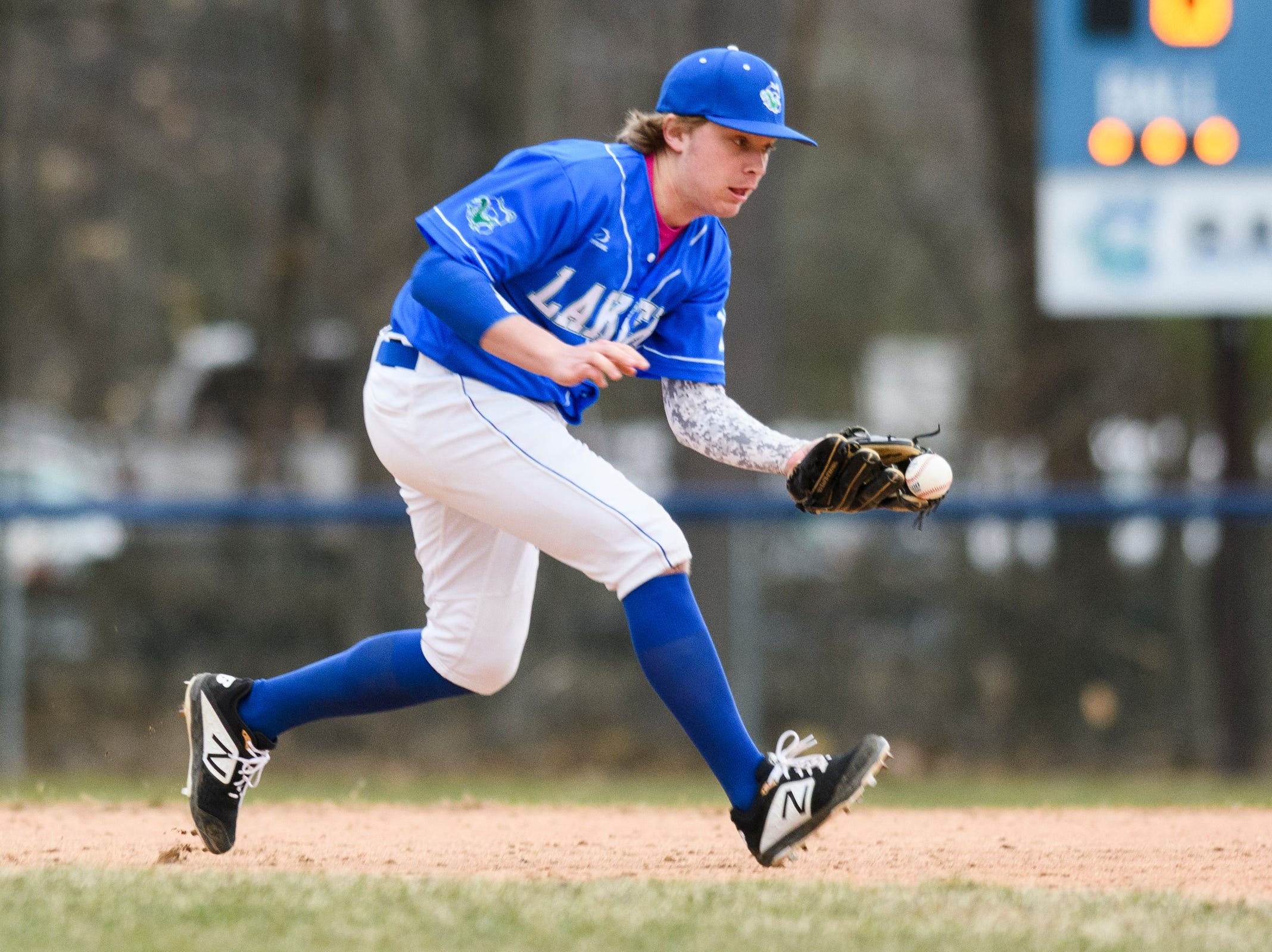 Colchester short stop Eben Provost (10) plays the ground ball during the boys baseball game between the South Burlington Wolves and the Colchester Lakers at Colchester high school on Thursday afternoon April 18, 2019 in Colchester, Vermont.