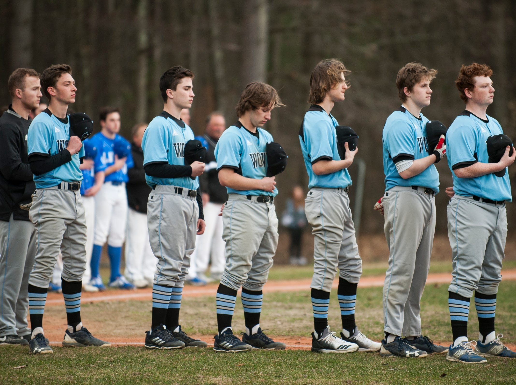 South Burlington listens to the National Anthem during the boys baseball game between the South Burlington Wolves and the Colchester Lakers at Colchester high school on Thursday afternoon April 18, 2019 in Colchester, Vermont.