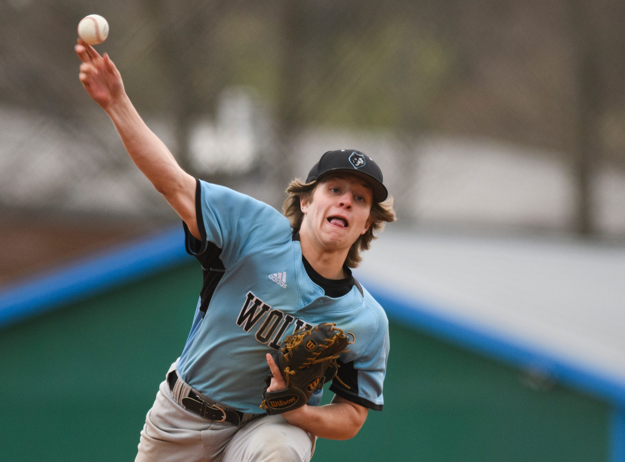 South Burlington pitcher Seamus McGrath (9) delivers a pitch during the boys baseball game between the South Burlington Wolves and the Colchester Lakers at Colchester high school on Thursday afternoon April 18, 2019 in Colchester, Vermont.