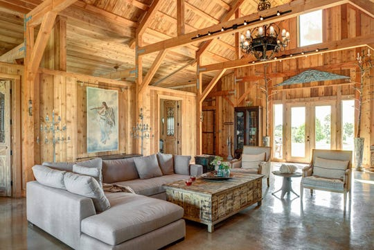 The Barn at the White House is located on 20-acres of rolling hills in Burton, Texas near Round Top, Texas. The rough cedar barn features elegant, rustic furniture and scenic views of nature.
