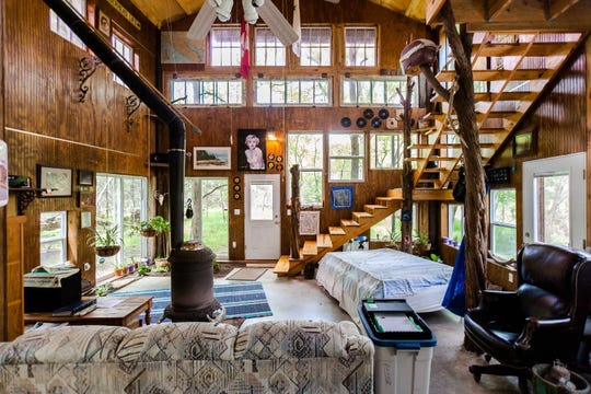 The two-story barndominium is located on six wooded acres in San Marcos, Texas. The tree house home features a barnwood interior and rusty tin exterior, 40 windows and is only seven miles from the town square.