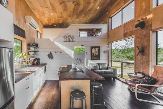 This farmhouse-modern guest cabin is located on a scenic ranch hidden away in Dripping Springs, Texas. It features a spacious open living area, bedroom, loft and grand porch.