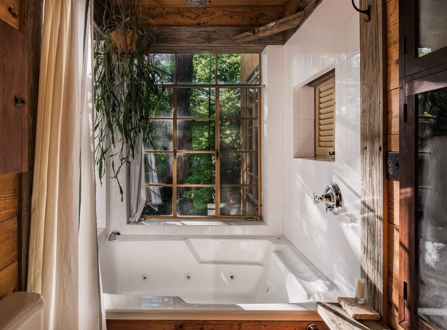 This handcrafted tree house is located in the heart of Little Forest Hills in Dallas, Texas. It features winding gravel foot paths through a forested canopy and has a rustic elegant atmosphere.