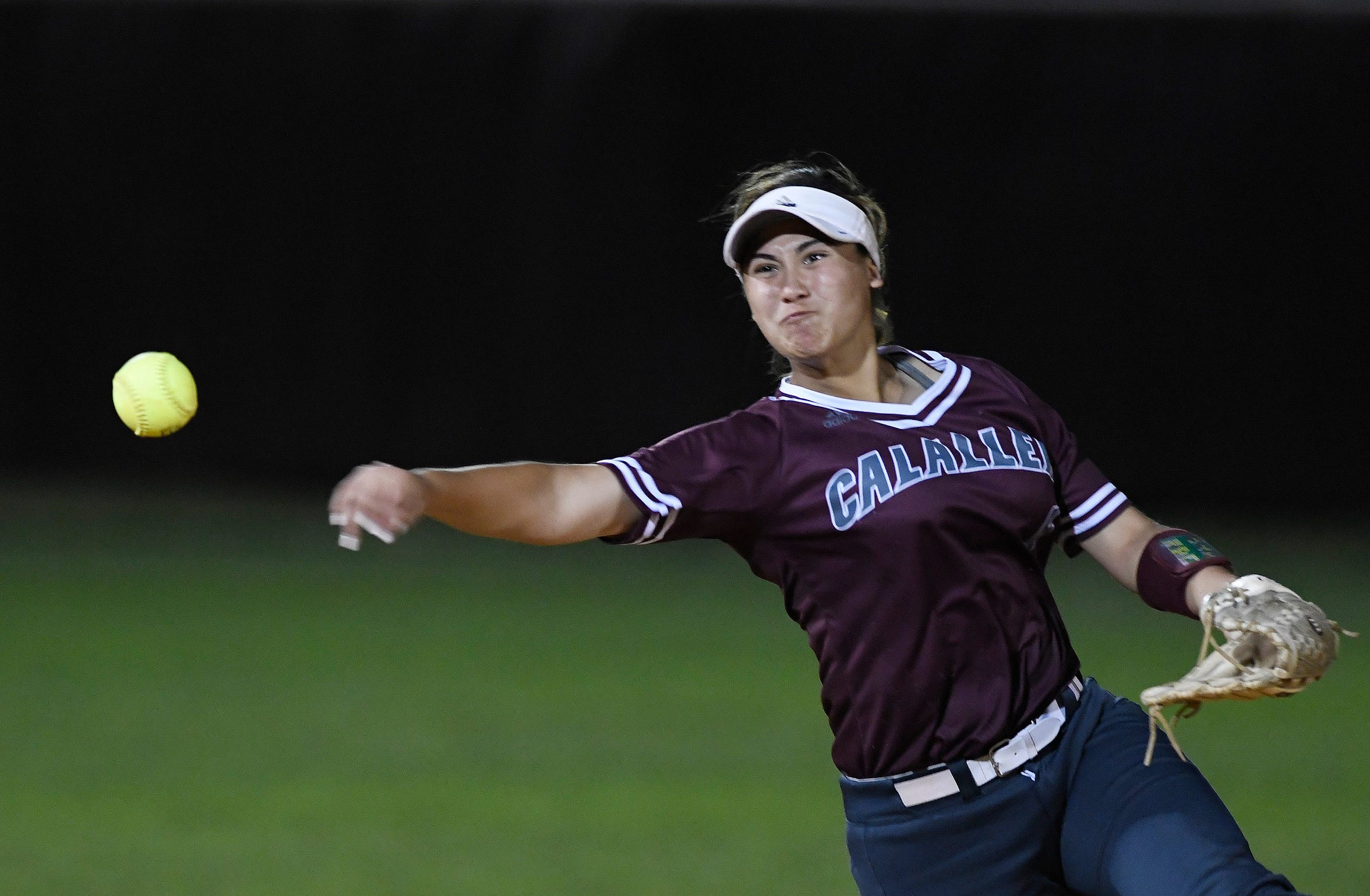 Calallen's Kat Flores throws the ball to first base during the game against Flour Bluff, Thursday, April 18, 2019, at Flour Bluff.