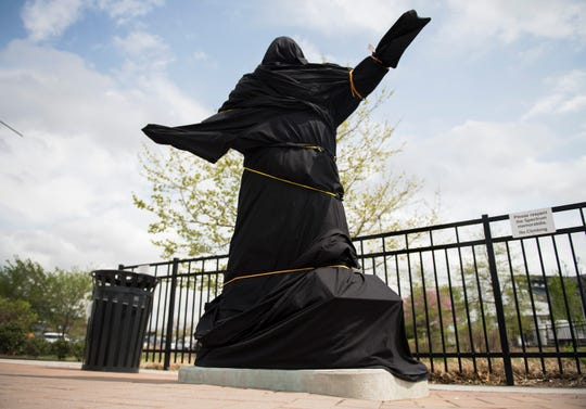 "A covered statue of Kate Smith stands outside the Wells Fargo Center in Philadelphia on Friday, April 19, 2019.  The Flyers covered the statue of the singer and cut ties with her recordings of  ""God Bless America,"" the team used to play on the scoreboard as a good-luck charm after several songs performed by Smith containing offensive lyrics have come to light."