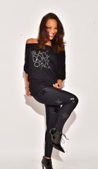 Debra Hubbard wears a top from her 'Black Don't Crack' inspirational clothing line.