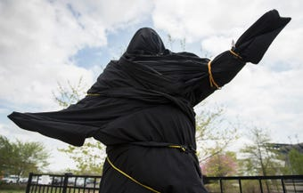 Flyers fan Ken Giusini of Philadelphia reacts after the Flyers covered the statue of Kate Smith after recordings of the singer containing offensive lyrics have come to light.