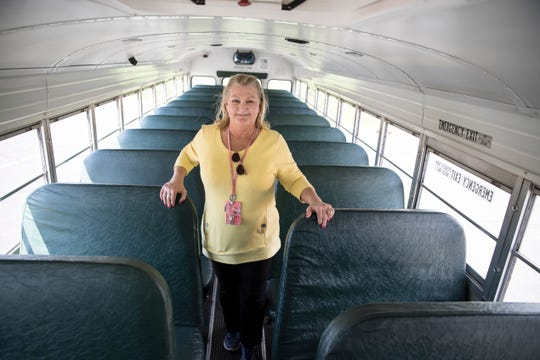 Adena Transportation Coordinator Joan Muntz stands in one of the buses that will be retired this year. This bus has been in use since 2002 and has been in use long after the average bus life.