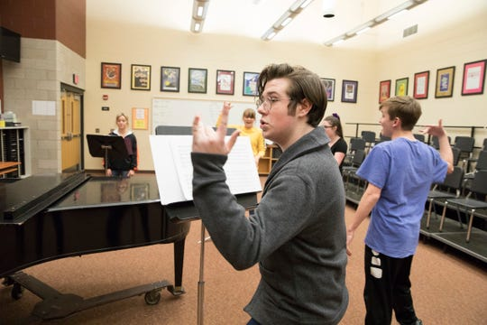 Polarity singer Jack Pfeifer puts a little rhythm into his performance as the group practices for the national competition in May.