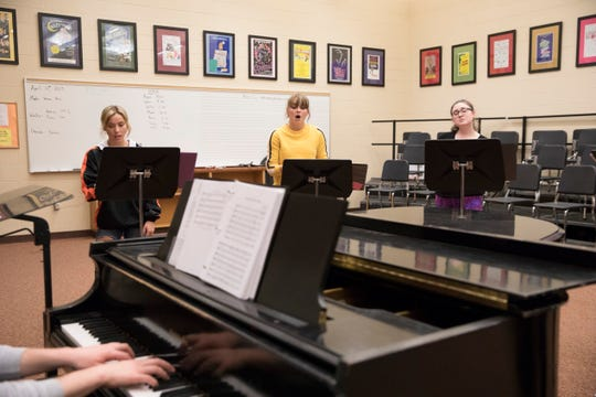 Polarity female members (l-r) Fabby Corwin, Mattie Elliott, Kayleah Shiland practice a new song Monday afternoon at Waverly High School.