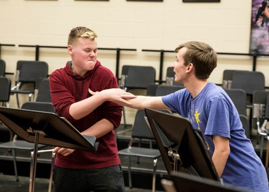 Polarity members Noah Clifton, left, and Andrew Pfeifer keep it fun in between songs Monday afternoon at Waverly High School.
