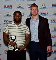 Miyan Williams of Winton Woods was the Boys Big School Football award winner and shared a photo moment with Cincinnati Bengals Quarterback Andy Dalton at the 2019 Cincinnati.com Sports Awards.