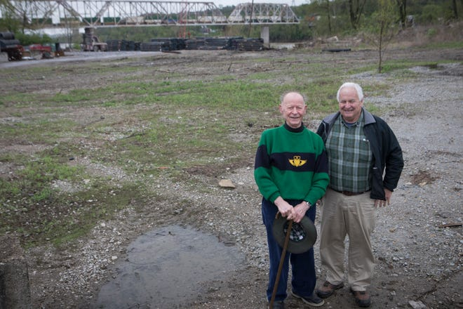 Jack Degano, left, and Gregory Lang are members of a group who want to turn a stretch of riverfront in Lower Price Hill into a park. They oppose a plan to move a concrete maker's operation near the park site. Here they stand on the proposed parkland they plan to call Price's Landing on Friday, April 19, 2019.