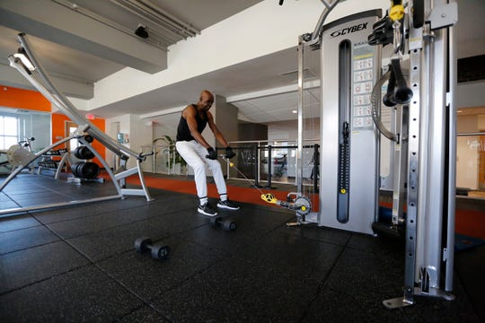 Lindsey Bolar works through his lifting routine at the Central Parkway YMCA in the Over-the-Rhine neighborhood of Cincinnati on March 11. Bolar spent time living in the same YMCA as a teen after his stepfather kicked him out of the house when his parents discovered his drug addiction. He says he was 14.