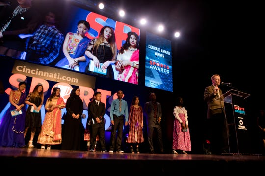 The Aiken High School cross country team receives the courage award during the Cincinnati.com Sports Awards, sponsored by TriHealth, on Thursday, April 18, 2019 at Cincinnati Music Hall in Cincinnati.