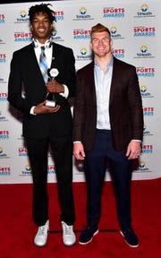 "Boys Basketball small school award winner Dieonte Miles of Walton-Verona gets a ""photo op"" with Cincinnati Bengals Quarterback Andy Dalton at the 2019 Cincinnati.com Sports Awards at Music Hall, April 18, 2019."
