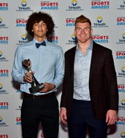 Wyoming's Evan Prater had a quarterbacks photo moment with Cincinnati Bengals Quarterback Andy Dalton after winning the Boys Small School Football award at the 2019 Cincinnati.com Sports Awards at Music Hall, April 18, 2019.