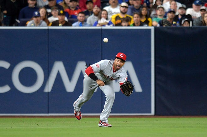 Apr 18, 2019; San Diego, CA, USA; Cincinnati Reds left fielder Matt Kemp (27) makes a play on a ball hit by San Diego Padres right fielder Franmil Reyes (not pictured) to end the fourth inning at Petco Park. Mandatory Credit: Jake Roth-USA TODAY Sports