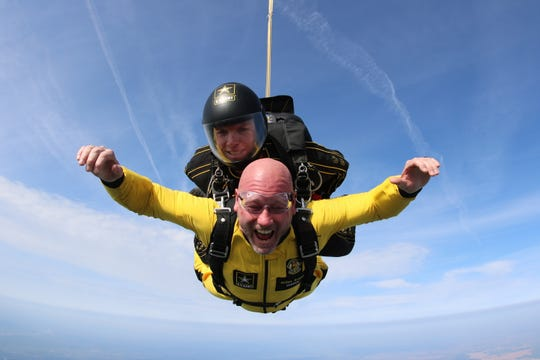 Former NFL quarterback and Lipscomb coach Trent Dilfer jumps with the Army Golden Knights parachute team at Clarksville Regional Airport on Wednesday, April 17, 2019.