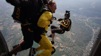 APSU head football Coach Mark Hudspeth jumps with the Army Golden Knights parachute team. (Note: Hudspeth segment begins at 1:00.)