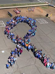 Parker Elementary School, a sea of blue, gathered to recognize Autism Awareness Day.