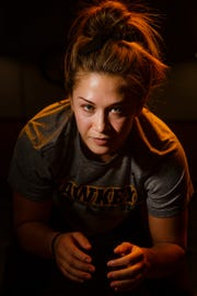 Hawkeye Wrestling Club freestyle wrestler Alli Ragan poses for a portrait before practice on Thursday, April 18, 2019, in Iowa City. Ragan is one of five Senior-level womenÕs wrestlers. Their addition to the Hawkeye Wrestling Club has helped womenÕs wrestling continued its rapid growth.