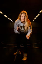 Hawkeye Wrestling Club freestyle wrestler Michaela Beck poses for a portrait before practice on Thursday, April 18, 2019, in Iowa City. Beck is one of five Senior-level womenÕs wrestlers. Their addition to the Hawkeye Wrestling Club has helped womenÕs wrestling continued its rapid growth.