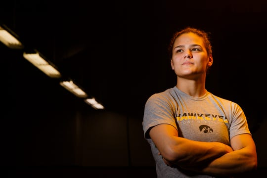 Hawkeye Wrestling Club freestyle wrestler Kayla Miracle poses for a portrait before practice on Thursday, April 18, 2019, in Iowa City. Miracle is one of five Senior-level womenÕs wrestlers. Their addition to the Hawkeye Wrestling Club has helped womenÕs wrestling continued its rapid growth.
