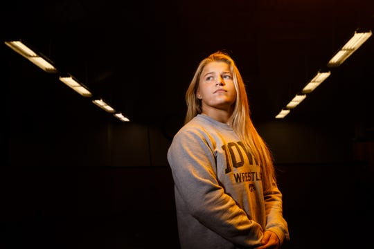 Hawkeye Wrestling Club freestyle wrestler Michaela Beck poses for a portrait before practice on Thursday, April 18, 2019, in Iowa City.