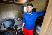 Iowa Cubs right-handed pitcher Trevor Clifton stands for a photo in the tiny house he built to live in during the baseball season Monday, April 15, 2019.