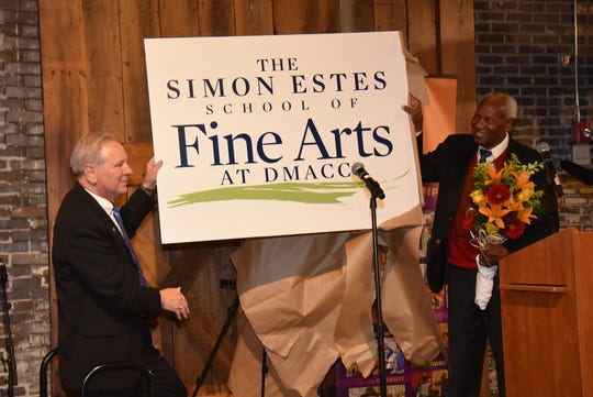 DMACC president Rob Denson, left, and Simon Estes unveil a sign for the new Simon Estes School of FIne Arts. DMACC will launch the school, named for the internationally known opera singer, this fall.