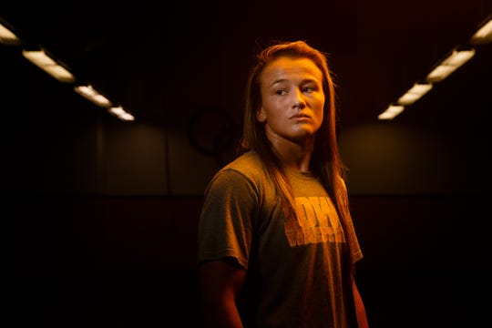 Hawkeye Wrestling Club freestyle wrestler Forrest Molinari poses for a portrait before practice on Thursday, April 18, 2019, in Iowa City. Molinari is one of five Senior-level womenÕs wrestlers. Their addition to the Hawkeye Wrestling Club has helped womenÕs wrestling continued its rapid growth.