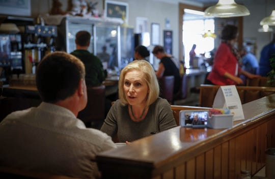 U.S. Senator and democratic presidential candidate hopeful Kirsten Gillibrand (D-NY) speaks with journalist and political science professor Bob Beatty after visiting with supporters at Cronks restaurant in Denison on Friday, April 19, 2019.