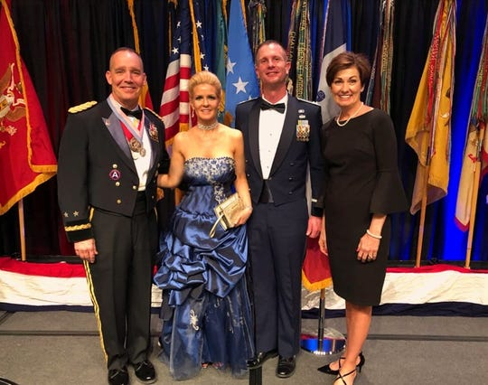 Major General Timothy Orr, newlyweds Hollie and Dave Zajicek and Governor Kim Reynolds at the adjunct general's officer's recognition event March 30.