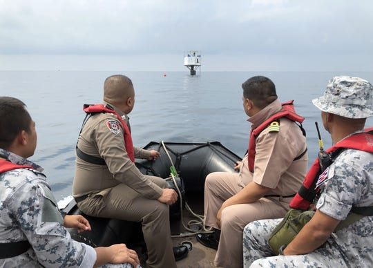 Royal Thai Navy officers inspect the seastead in the Andaman Sea, some 12 nautical miles off the coast of Phuket.