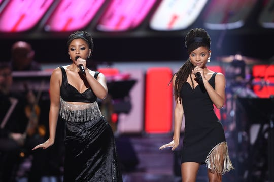 """Chloe Bailey (left) and Halle Bailey of Chloe x Halle perform at """"Motown 60: A Grammy Celebration"""" at Microsoft Theater on Feb. 12, 2019, in Los Angeles."""