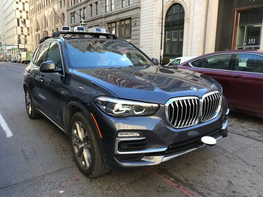 A BMW X5 is outfitted with various sensors to help demonstrate Montana-based Blackmore's lidar technology during a drive in Detroit April 9.