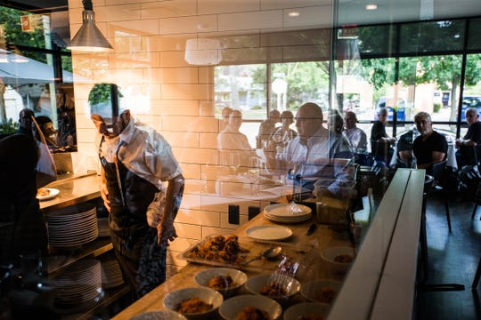 The glass-encased kitchen at Forest in Birmingham is in full view of the dining room.