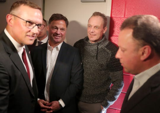 Former Detroit Red Wings players Dino Ciccarelli and Darren McCarty watch as former teammate Steve Yzerman, far left, named the new general manager of the team, takes questions Friday, April 19, 2019 at Little Caesars Arena in Detroit, Mich.