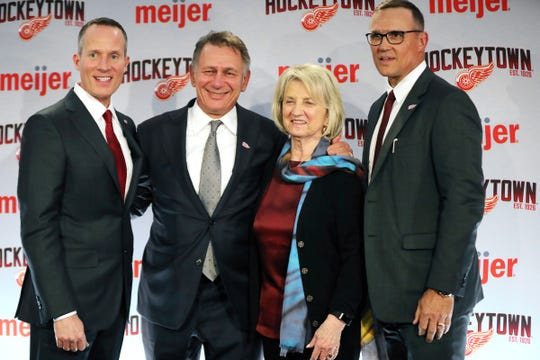 From left, Christopher Ilitch, Ken Holland, Marian Ilitch and new Detroit Red Wings GM Steve Yzerman pose for a photo following a press conference Friday, April 19, 2019 at Little Caesars Arena in Detroit, Mich.