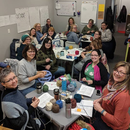 Participants of a Saturday Knit-Along at Threadbender cast-on stitches for new projects.