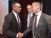 Former teammates Steve Yzerman, left, and Kris Draper shake hands after Yzerman was introduced as the Red Wings' new general manager.