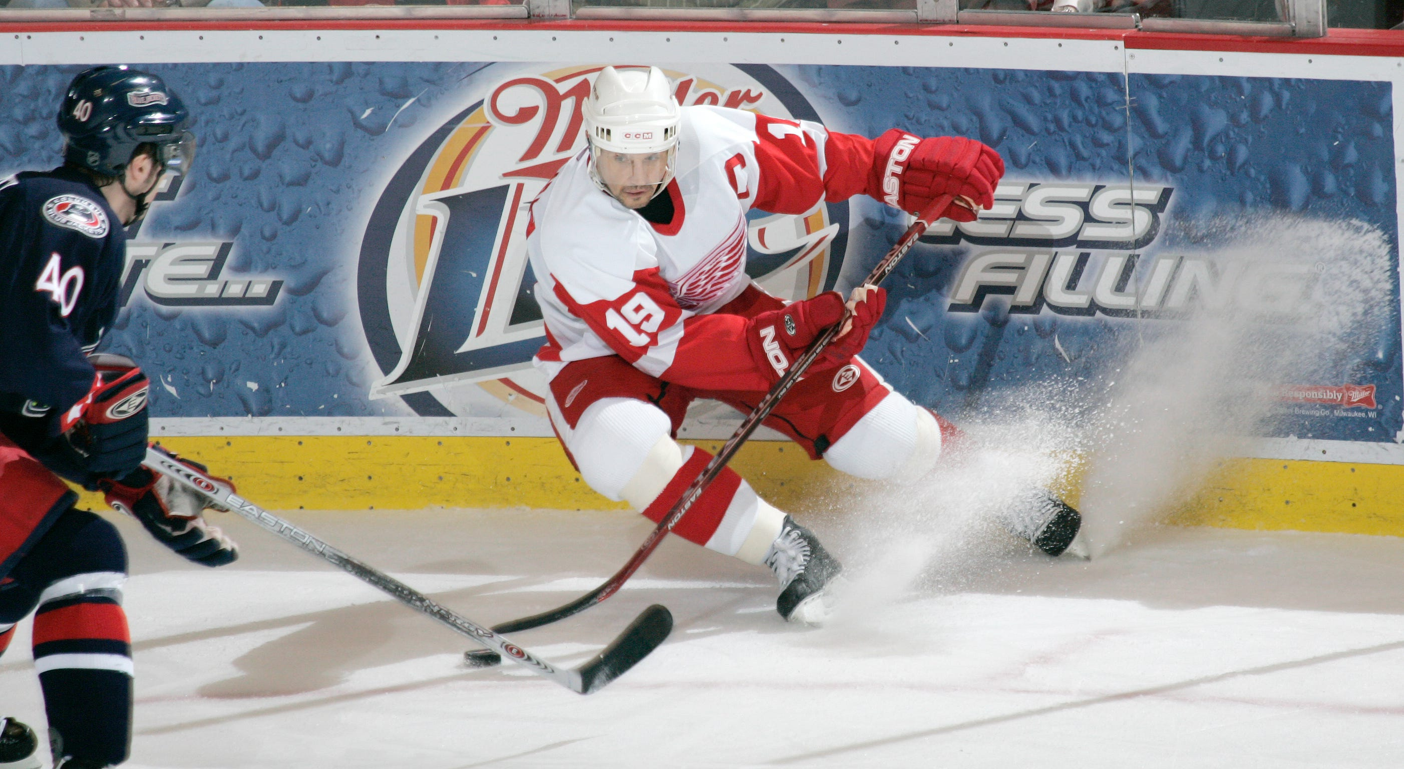 Red Wings captain Steve Yzerman puts on the brakes in front of Blue Jackets Jaroslav Balastik in a 2006 game.