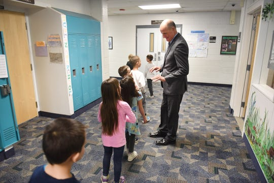 Dublin Elementary principal Jeffrey Drewno talks with students at the White Lake school on Wednesday, April 17, 2019. The 91-year-old building will be replaced by a new facility if ] voters approve a $316 million bond issue for Walled Lake Consolidated Schools on the May 7 ballot. 