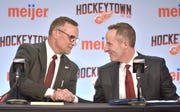 Steve Yzerman, left, shakes hands with Chris Ilitch after the former Red Wings captain was named GM on Friday.