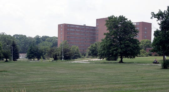 Northville Township trustees approved a plan Thursday for hiking and biking trails on a portion of the site of a former psychiatric hospital.