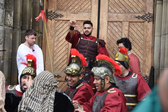 Pontius Pilate, played by Ricardo Hernandez, center, condemns Jesus Christ to death as guards hold off his supporters.