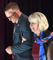 New Red Wings GM Steve Yzerman, left, escorts owner Marian Ilitch during Friday's press conference.