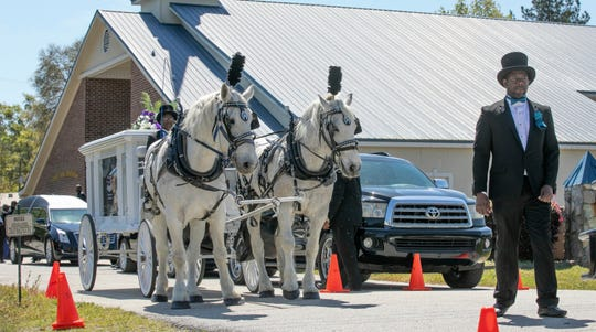 In April 3, 2019,  a horse-drawn caisson arrives outside Saints Center Ministries in Walterboro, S.C., for a celebration of the life 10-year-old Raniya Wright.